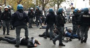 German football fans clash with Rome riot police