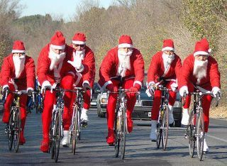 Santa Clauses on bicycles in Rome