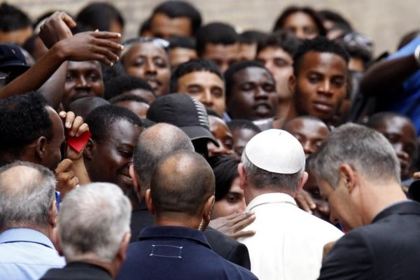 Pope Francis visits Rome refugee centre
