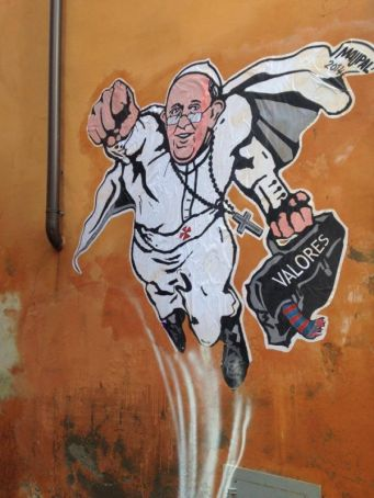 Rome paints out Super Pope mural