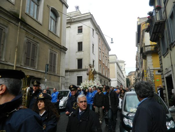 St Joseph is carried high through the streets of Monti