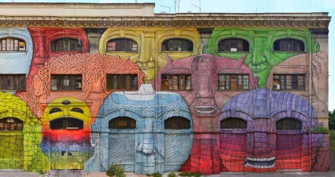 Mural by BLU on Via del Porto Fluviale.
