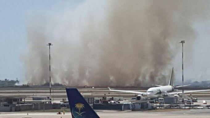 Fire near Rome's Fiumicino airport grounds flights