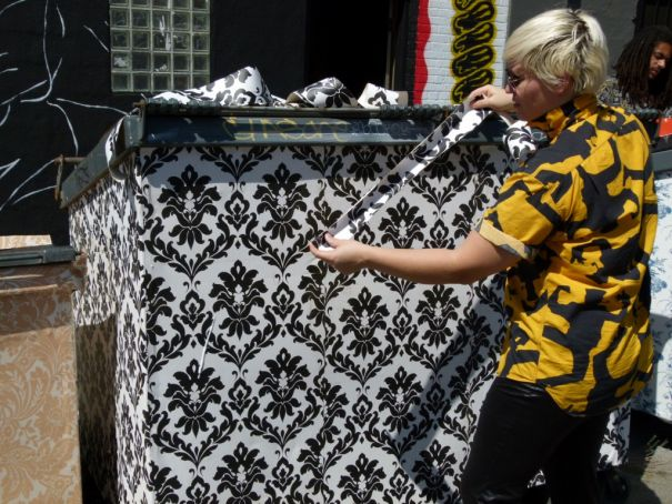 C. Finley and one of her Wallpapered Dumpsters. Photo by Tanja M. Laden.