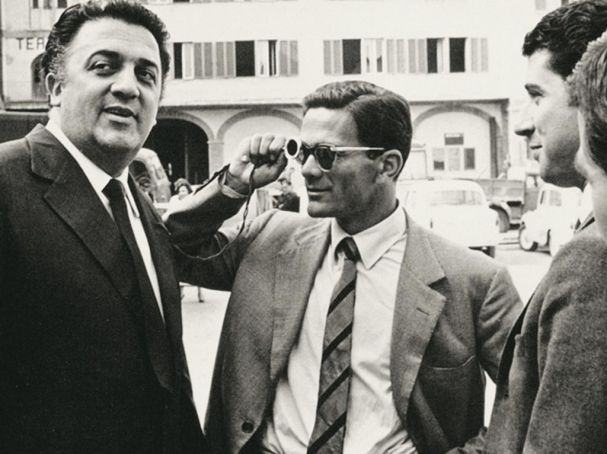 Federico Fellini (left) employed Pasolini as a consultant for his 1957 film Le notti di Cabiria.