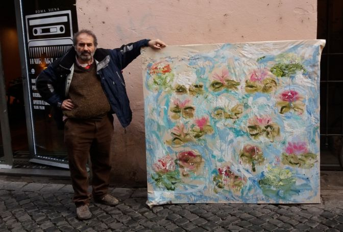 Giancarlino with one of his flower paintings on Via dei Cappellari.