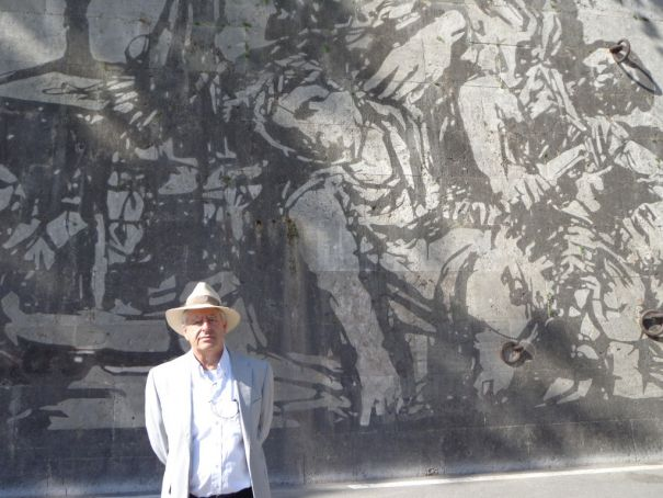 Kentridge in front of Triumphs and Laments.