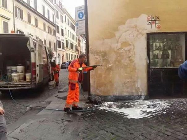AMA Roma workers remove Maupal mural.