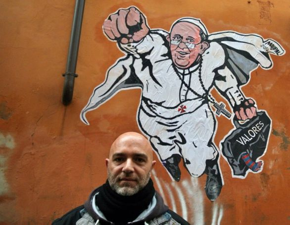 Maupal in front of his Super-Pope image in 2014