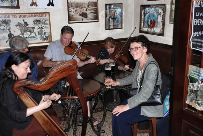 Mary Pyne, far right, enjoying some traditional Irish music.