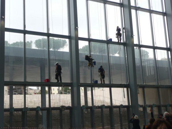 workmen on face of La Nuvola