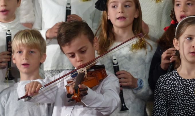 Jonah Giuliani plays violin for Ambrit's Winter Recital.