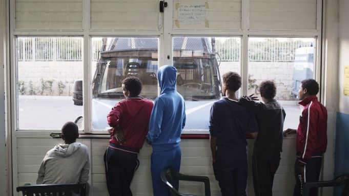 A group of young Eritreans at a migrant reception centre in Pozzallo, Sicily.