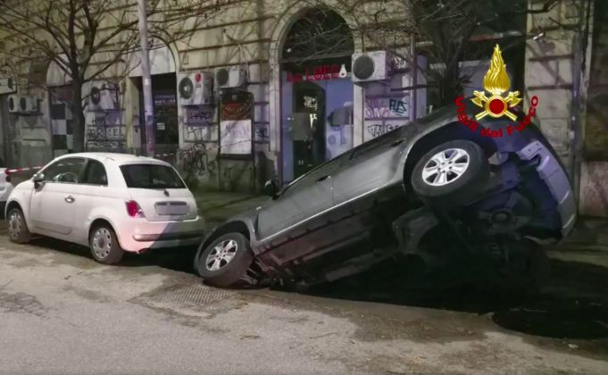 Rome sinkhole swallows two cars