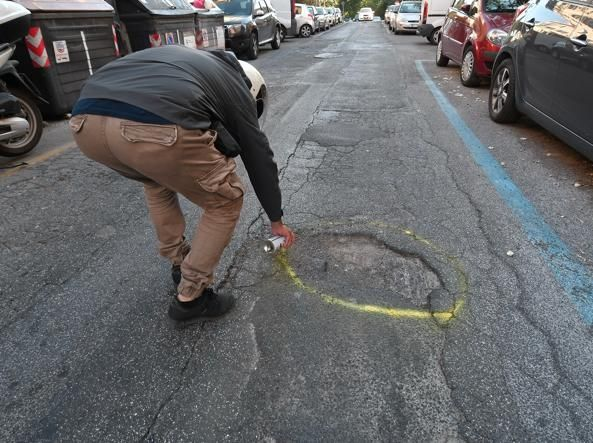 Romans highlight city's potholes with spray paint