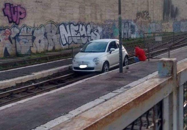 Car stuck on train tracks at Rome's Termini station