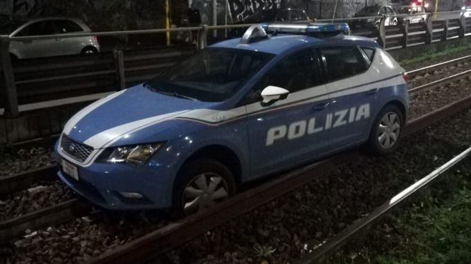 Rome police car stuck on train tracks
