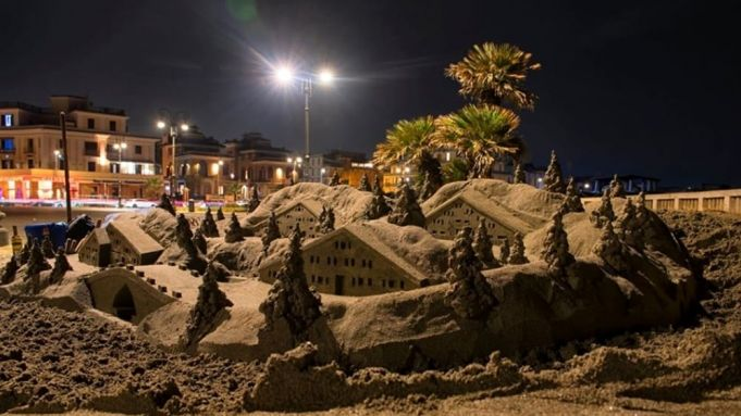 Rome artist turns storm sand into crib on Ostia pier