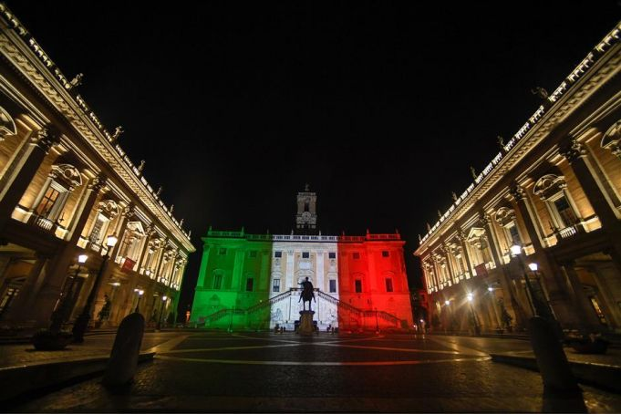 Italy's flag lights up its darkest hour