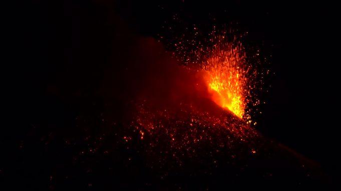 Italy's Mount Etna volcano spews lava into night sky
