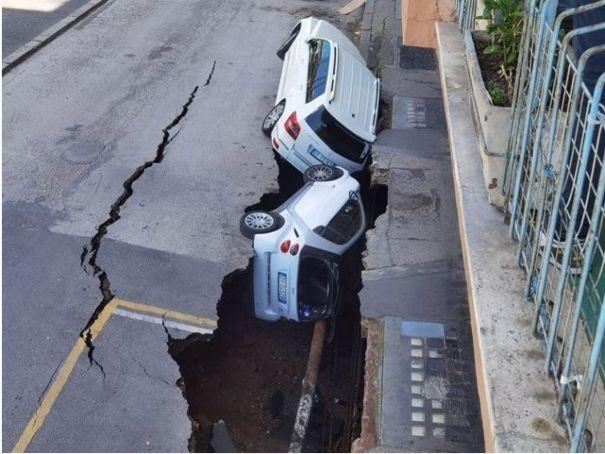 Sinkhole swallows cars on Rome street