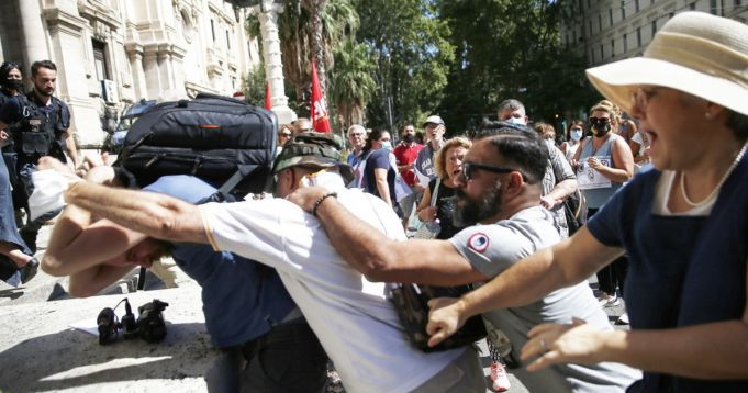 Italy Green Pass protesters attack journalists