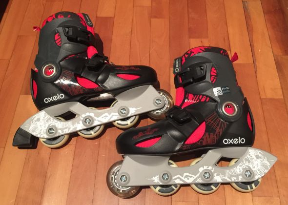 Black and red child rollerblades - image 1