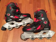 Black and red child rollerblades