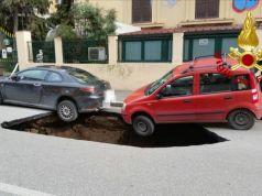 Sinkhole opening on Rome street