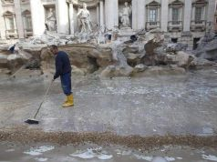 Rome delays taking Trevi Fountain coins away from charity