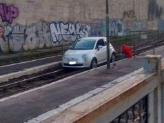 Car stuck on train tracks at Rome's Termini station