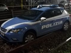 Rome police car stuck on train tracks