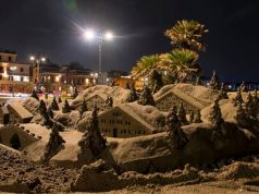 Rome artist turns storm sand into crib on Ostia pier