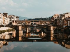 Florence: tourist writes name on Ponte Vecchio