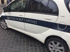 Rome traffic cops have sex in the service car with the radio on