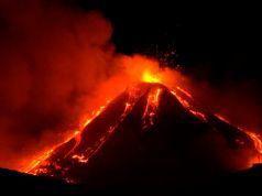 Italy's Mount Etna volcano spews lava into night sky