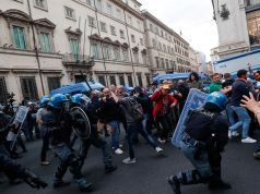 Rome protest over Italy's covid Green Pass turns violent