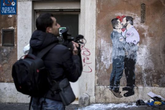 Rome mural of Salvini and Di Maio kissing