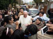 Pope Francis makes surprise visit to Rome shantytown