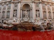 Activist dyes Trevi Fountain waters red