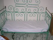 Old wrought iron garden and Queen-size bed in same style
