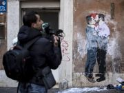 Rome mural of Salvini and Di Maio kissing