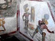 Fresco of fighting gladiators unearthed at Pompeii