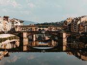 Florence: tourist writes name on Ponte Vecchio