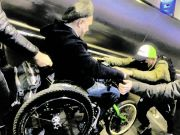 Rome's central train station with no lifts: commuters carry wheelchair user