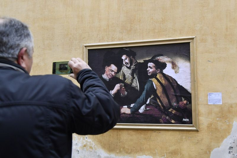 Rome police remove political street art