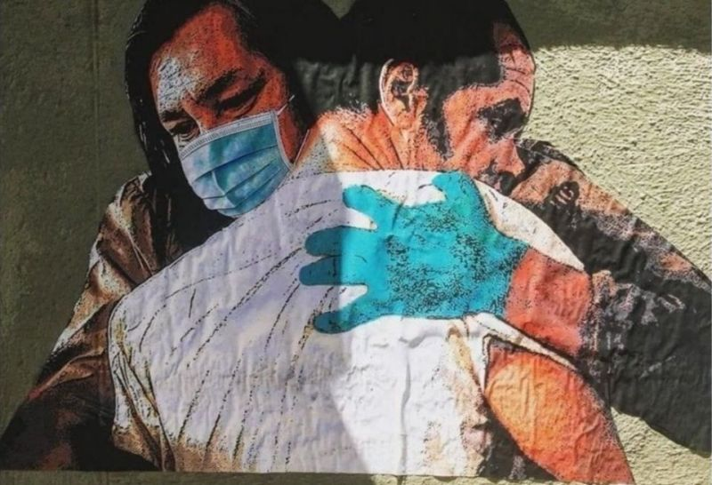 Rome street artist's Hug mural for Spallanzani